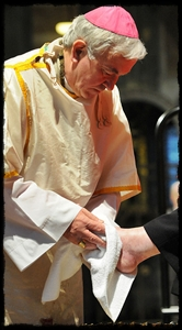 Archbishop Nichols of U.K. washes feet on Holy Thursday.