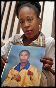 LaTona Gunn holds a 2001 photo of her daughter, Sakia Gunn, at her home in Newark. Sakia, 15, was stabbed to death while waiting for the bus in Newark after she and her friends told her attacker they were lesbians.