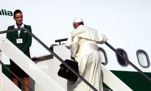 Pope Francis boards commercial flight for Brazil for World Youth Day.