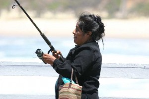 hispanic-woman-fishing-pismo-pier