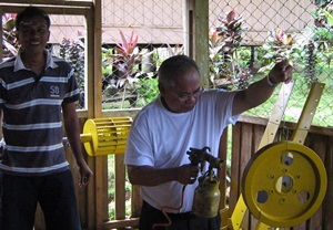 Cardinal Quevedo helps paint turbines in rural Philippines.