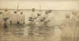 1024px-River_baptism_in_New_Bern
