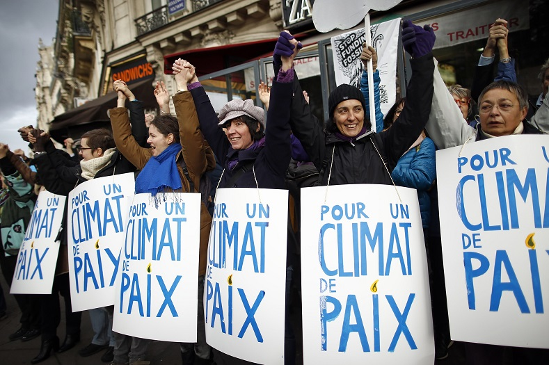 People form a human chain to show solidarity for climate change after the cancellation of a planned climate march ahead of the World Climate Change Conference 2015 in Paris