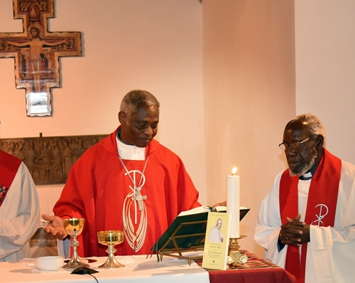Cardinal Turkson and Archbishop Paride (right) celebrate Eucharist.