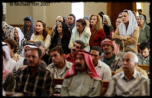 Christians and Muslims attend Mass in Baghdad as a celebration for Muslims rebuilding the church.