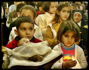 Iraqi children bring Christ Child to Creche on Christmas