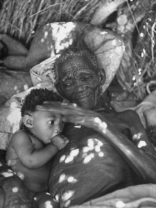old-bushman-woman-holding-a-baby