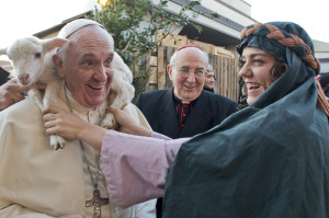 Woman portraying figure in Nativity scene puts lamb around neck of Pope Francis during visit to Rome church